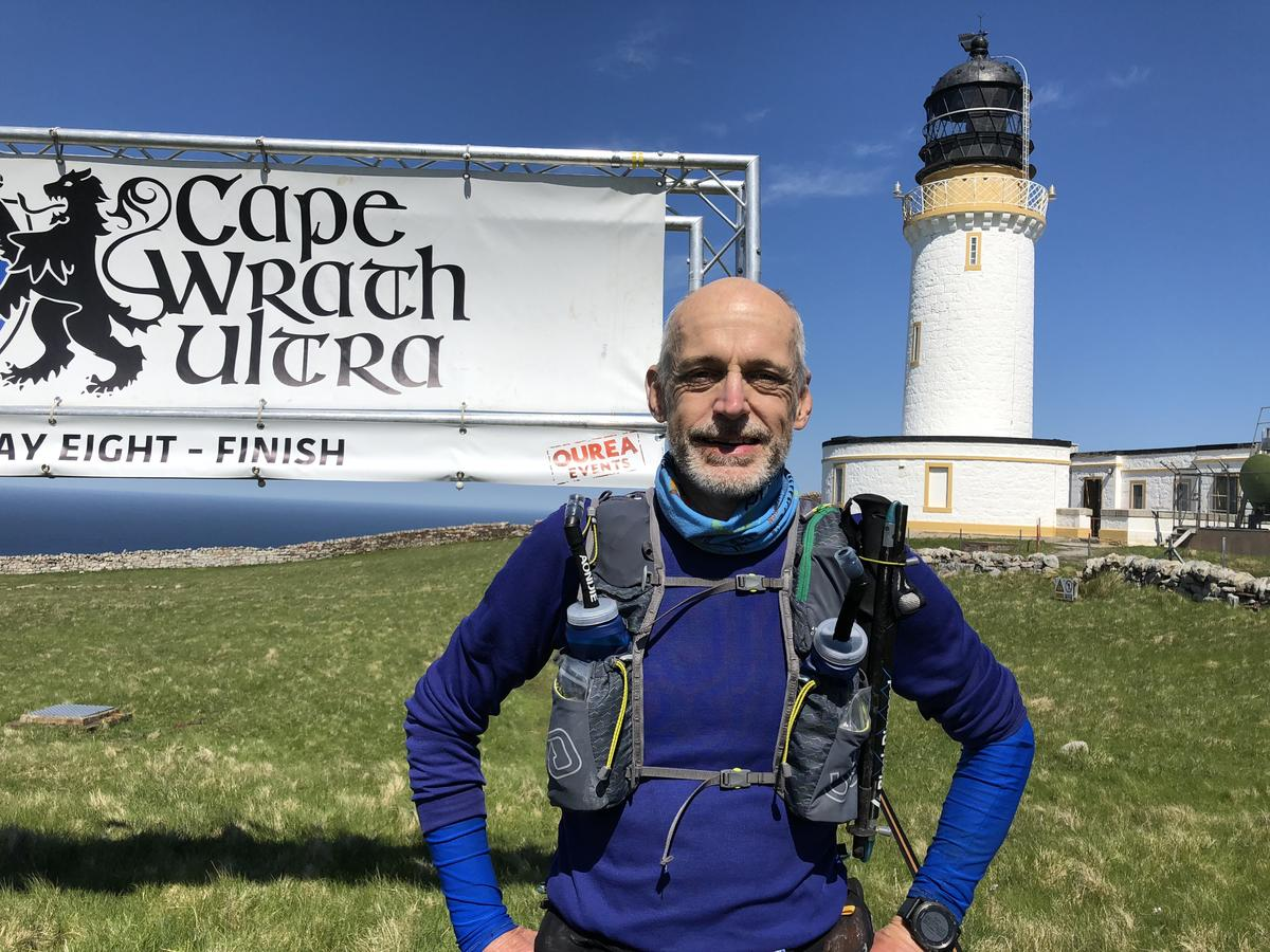 Finishing the route at Cape Wrath, Scotland, in front of the lighthouse